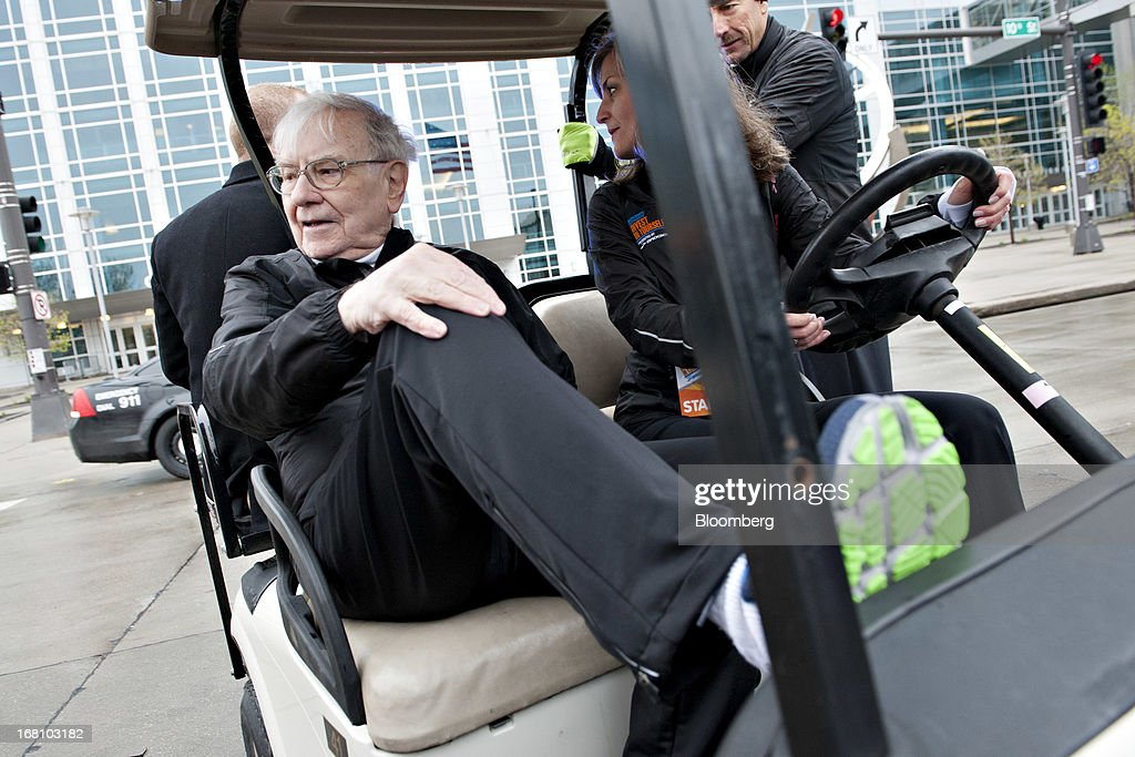 Warren Buffett, chairman and chief executive officer of Berkshire Hathaway, Inc., leaves after firing the starting gun during the 'Berkshire Hathaway Invest In Yourself 5K' race presented by Brooks Sports, Inc., a Berkshire company, in Omaha, Nebraska, U.S., on Sunday, May 5, 2013. Warren Buffett, the leader of Berkshire Hathaway since the 1960s, said the company's next chief executive officer will bolster the company's reputation as a source of stability in times of crisis. Photographer: Daniel Acker/Bloomberg via Getty Images