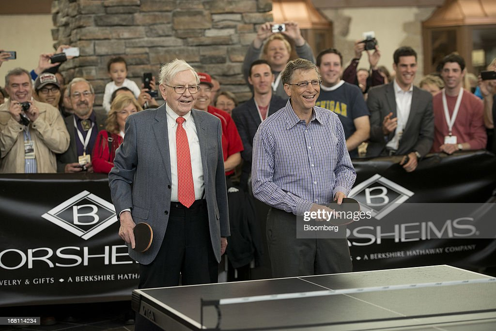 Warren Buffett, chairman and chief executive officer of Berkshire Hathaway, Inc., left, stands with Bill Gates, chairman and founder of Microsoft Corp., as they play table tennis outside Borsheims Jewelry Company, Inc., in Omaha, Nebraska, U.S., on Sunday, May 5, 2013. Warren Buffett, the leader of Berkshire Hathaway since the 1960s, said the company's next chief executive officer will bolster the company's reputation as a source of stability in times of crisis. Photographer: Daniel Acker/Bloomberg via Getty Images