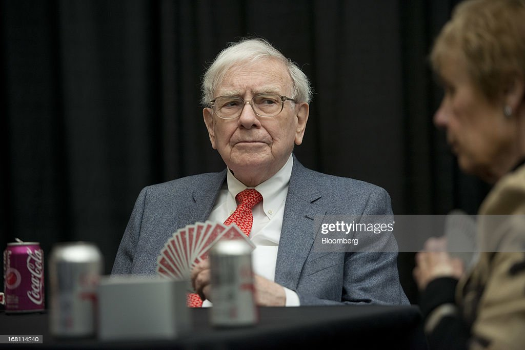 Warren Buffett, chairman and chief executive officer of Berkshire Hathaway, Inc., plays bridge with shareholders during an event in Omaha, Nebraska, U.S., on Sunday, May 5, 2013. Warren Buffett, the leader of Berkshire Hathaway since the 1960s, said the company's next chief executive officer will bolster the company's reputation as a source of stability in times of crisis. Photographer: Daniel Acker/Bloomberg via Getty Images