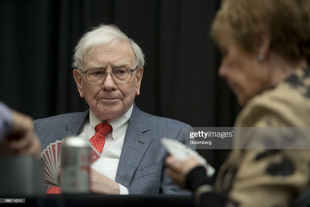 <a gi-track='captionPersonalityLinkClicked' href=/galleries/search?phrase=Warren+Buffet&family=editorial&specificpeople=533069 ng-click='$event.stopPropagation()'>Warren Buffet</a>t, chairman and chief executive officer of Berkshire Hathaway, Inc., plays bridge with shareholders during an event in Omaha, Nebraska, U.S., on Sunday, May 5, 2013. <a gi-track='captionPersonalityLinkClicked' href=/galleries/search?phrase=Warren+Buffet&family=editorial&specificpeople=533069 ng-click='$event.stopPropagation()'>Warren Buffet</a>t, the leader of Berkshire Hathaway since the 1960s, said the company's next chief executive officer will bolster the company's reputation as a source of stability in times of crisis. Photographer: Daniel Acker/Bloomberg via Getty Images