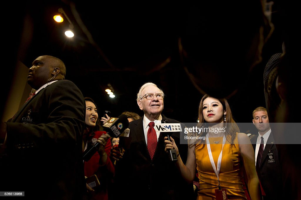 Warren Buffett, chairman and chief executive officer of Berkshire Hathaway Inc., speaks to members of the media as he tours the exhibition floor during the Berkshire Hathaway Inc. annual shareholders meeting in Omaha, Nebraska, U.S., on Saturday, April 30, 2016. Dozens of Berkshire Hathaway Inc. subsidiaries will be showing off their products as Chief Executive Officer Warren Buffett hosts the company's annual meeting. Photographer: Daniel Acker/Bloomberg via Getty Images