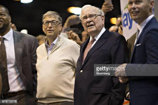 Warren Buffett chairman and chief executive officer of Berkshire Hathaway Inc center right and Bill Gates billionaire and cofounder of the Bill and...