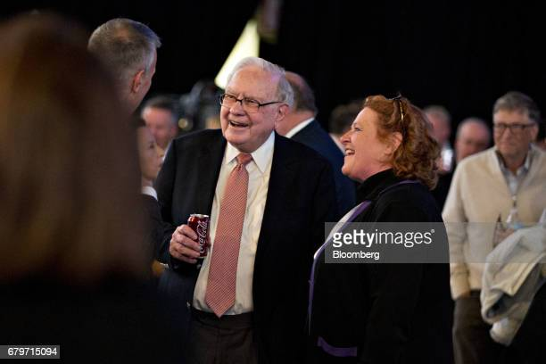 Warren Buffett chairman and chief executive officer of Berkshire Hathaway Inc holds a CocaCola Co can while speaking with attendees before the start...