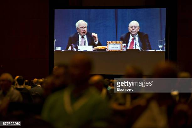 Warren Buffett chairman and chief executive officer of Berkshire Hathaway Inc left and Charlie Munger vice chairman of Berkshire Hathaway are seen on...
