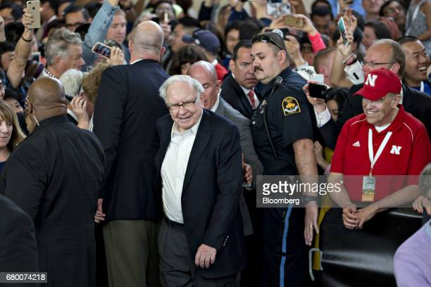 Warren Buffett chairman and chief executive officer of Berkshire Hathaway Inc center arrives to play table tennis at an event on the sidelines the...