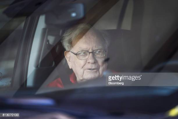 Warren Buffett chairman and chief executive officer of Berkshire Hathaway Inc sits in a car as he arrives for the Allen Co Media and Technology...