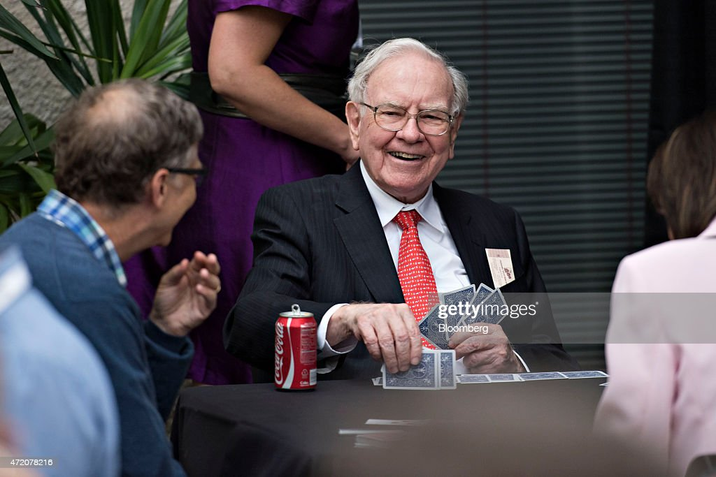 Warren Buffett chairman of Berkshire Hathaway Inc center laughs with Bill Gates chairman and founder of Microsoft Corp and a Berkshire Hathaway Inc...