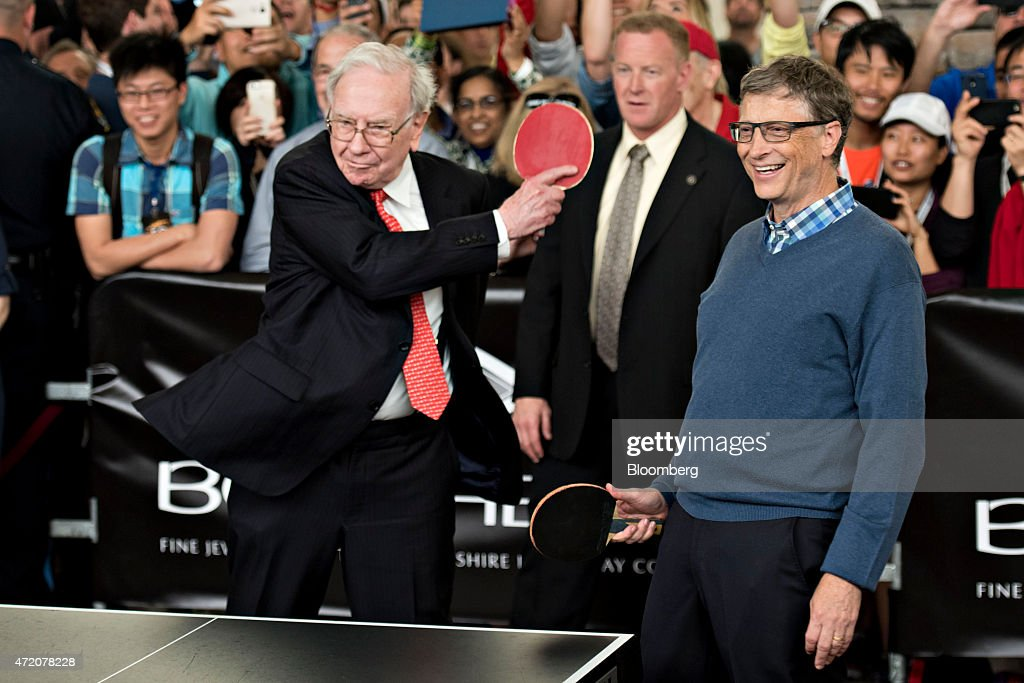 Warren Buffett chairman of Berkshire Hathaway Inc left plays ping pong with Bill Gates chairman and founder of Microsoft Corp and a Berkshire...