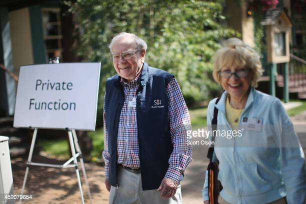 Warren Buffett chairman of Berkshire Hathaway Inc walks with his wife Astrid at the Allen Company Sun Valley Conference at the Sun Valley Resort on...