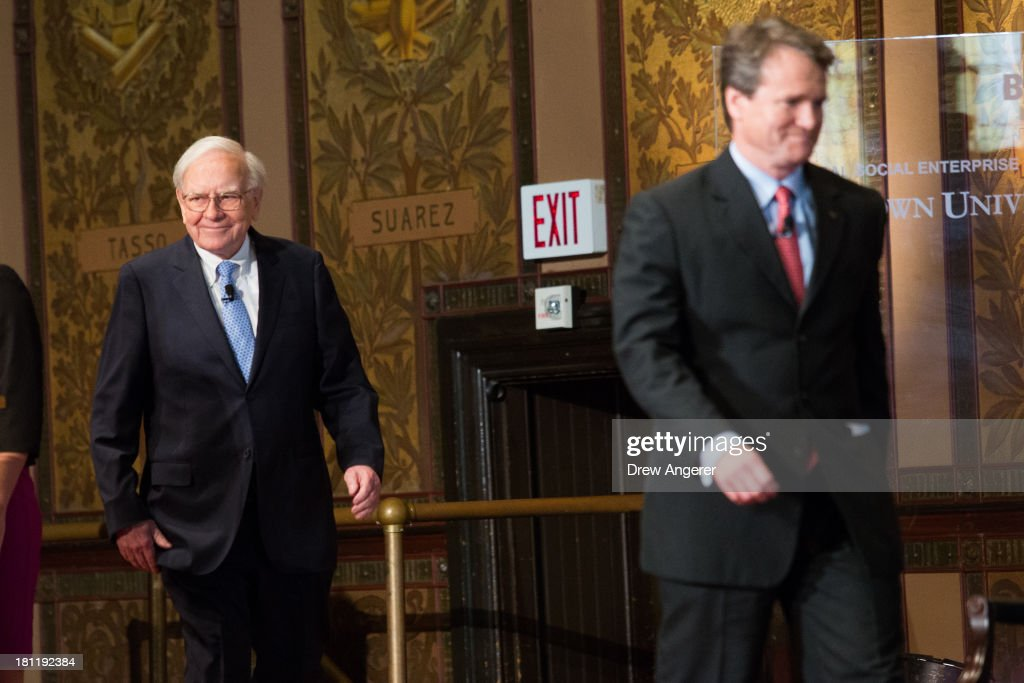 <a gi-track='captionPersonalityLinkClicked' href=/galleries/search?phrase=Warren+Buffett&family=editorial&specificpeople=533069 ng-click='$event.stopPropagation()'>Warren Buffett</a> (L), chairman of the board and CEO of Berkshire Hathaway, walks on stage with Bank of America CEO Brian Moynihan, before speaking in Gaston Hall at Georgetown University, September 19, 2013 in Washington, DC. Buffett also took questions from Georgetown students.