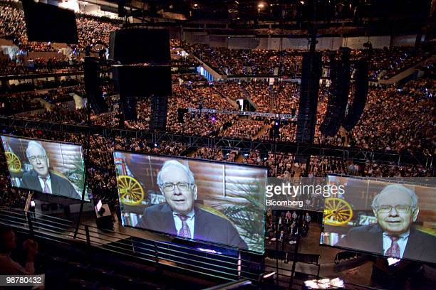 Warren Buffett chief executive officer of Berkshire Hathaway appears in a taped video message to shareholders prior to the start of the Berkshire...