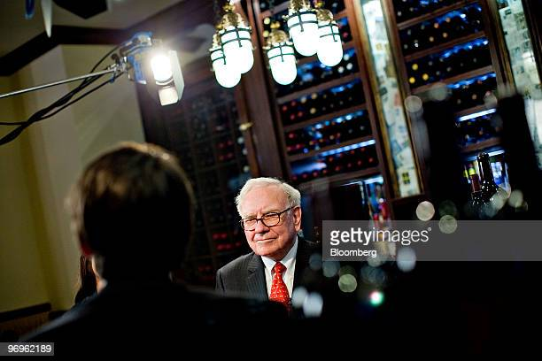 Warren Buffett chief executive officer of Berkshire Hathaway speaks during a television interview in advance of a charity lunch with a group led by...