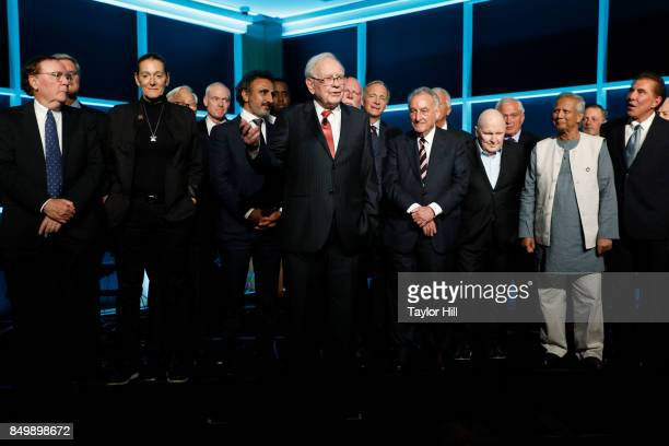 Warren Buffett speaks in honor of the Forbes Media Centennial Celebration at Pier 60 on September 19 2017 in New York City Among the people behind...