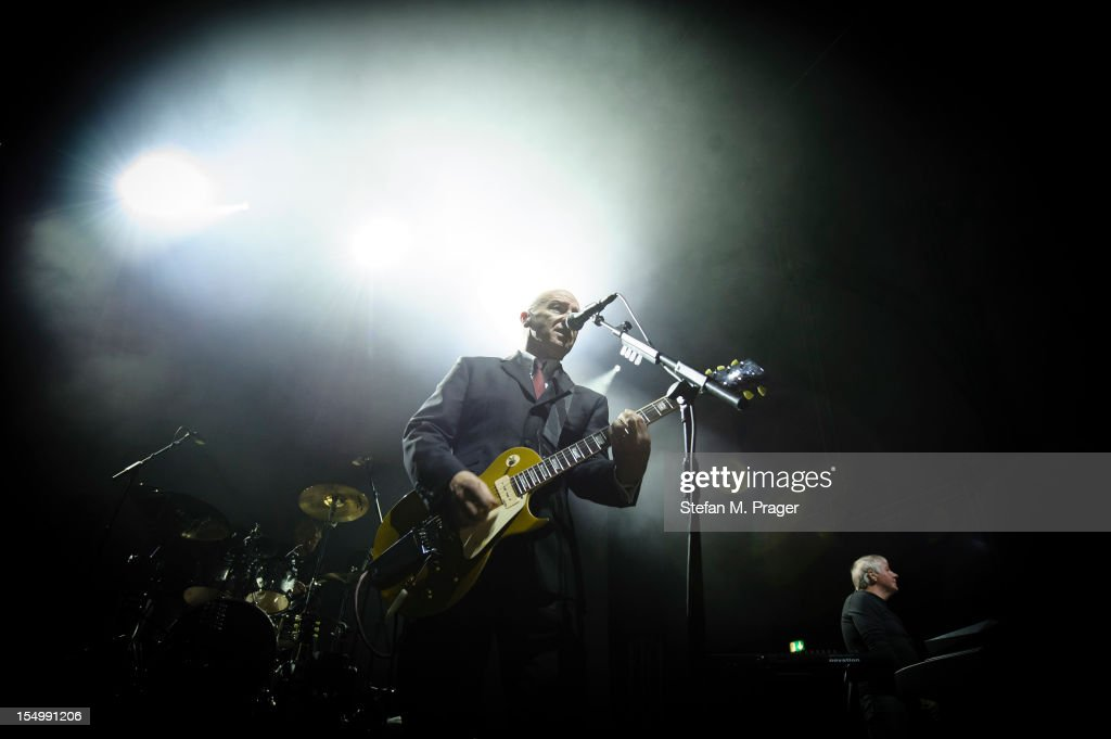 Warren Cann, <a gi-track='captionPersonalityLinkClicked' href=/galleries/search?phrase=Midge+Ure&family=editorial&specificpeople=206656 ng-click='$event.stopPropagation()'>Midge Ure</a> and Billy Currie of Ultravox perform on stage at Kesselhaus on October 29, 2012 in Munich, Germany.