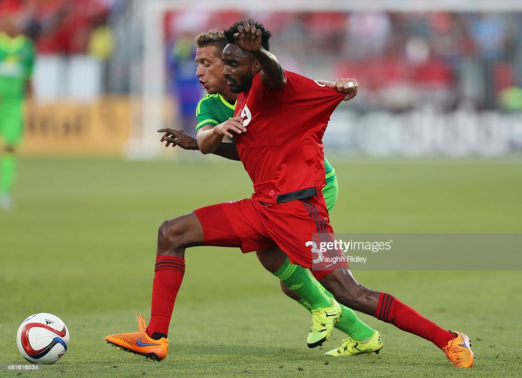 Warren Creavalle #3 of Toronto FC and Emanuele Giaccherini #23 of Sunderland AFC battle for the ball during a friendly match at BMO Field on July 22, 2015 in Toronto, Ontario, Canada.