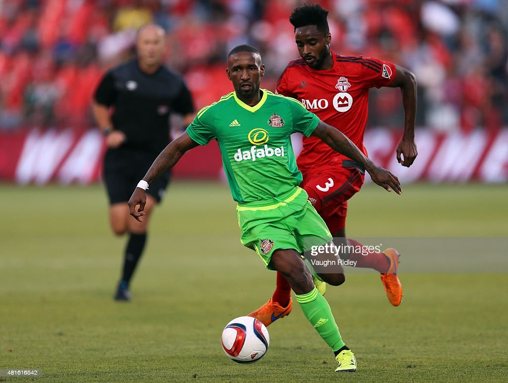 Warren Creavalle #3 of Toronto FC and Jermain Defoe #18 of Sunderland AFC battle for the ball during a friendly match at BMO Field on July 22, 2015 in Toronto, Ontario, Canada.