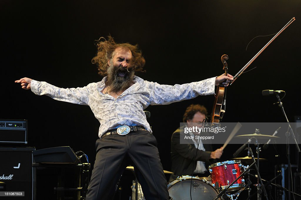 <a gi-track='captionPersonalityLinkClicked' href=/galleries/search?phrase=Warren+Ellis&family=editorial&specificpeople=4451382 ng-click='$event.stopPropagation()'>Warren Ellis</a> and Jim White of the band Dirty Three perform on stage during End Of The Road Festival 2012 at Larmer Tree Gardens on August 31, 2012 in Salisbury, United Kingdom.