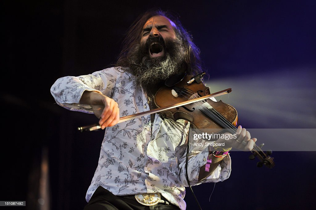 <a gi-track='captionPersonalityLinkClicked' href=/galleries/search?phrase=Warren+Ellis&family=editorial&specificpeople=4451382 ng-click='$event.stopPropagation()'>Warren Ellis</a> of the band Dirty Three performs on stage during End Of The Road Festival 2012 at Larmer Tree Gardens on August 31, 2012 in Salisbury, United Kingdom.