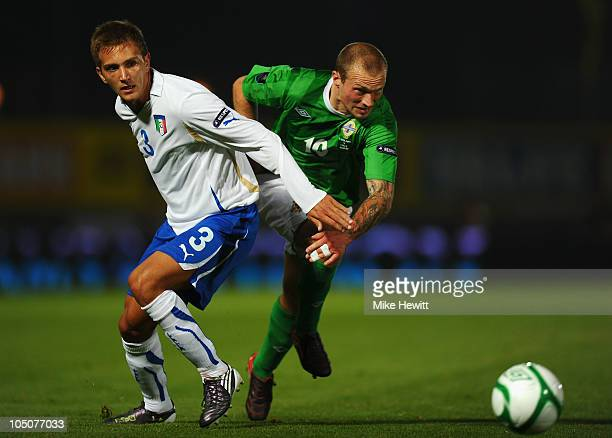 Warren Feeney of Northern Ireland gets past Domenico Criscito of Italy during the EURO 2012 Qualifier Group C match between Northern Ireland and...