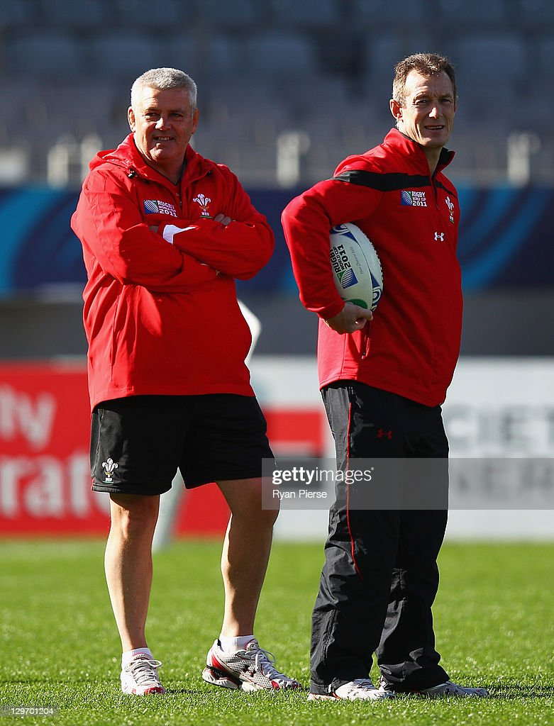 Warren Gatland (L), coach of Wales and assistant Rob Howley look on during a Wales IRB Rugby World Cup 2011 captain's run at Eden Park on October 20, 2011 in Auckland, New Zealand.