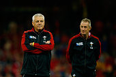 Warren Gatland Head Coach of Wales looks on with Rob Howley Attack Coach of Wales prior to the 2015 Rugby World Cup Pool A match between Wales and...
