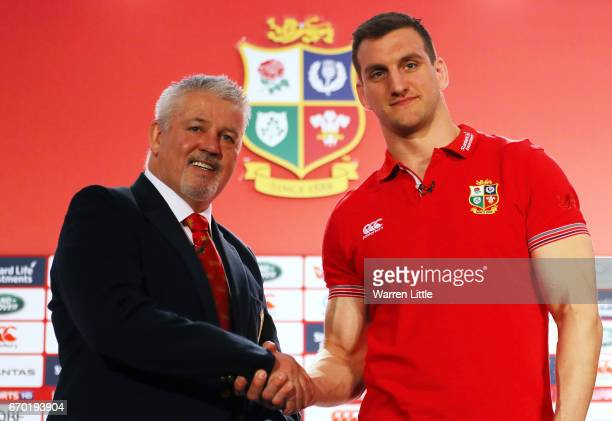 Warren Gatland shakes hands with Sam Warburton during the British and Irish Lions tour squad announcement at the Hilton London Syon Park Hotel on...