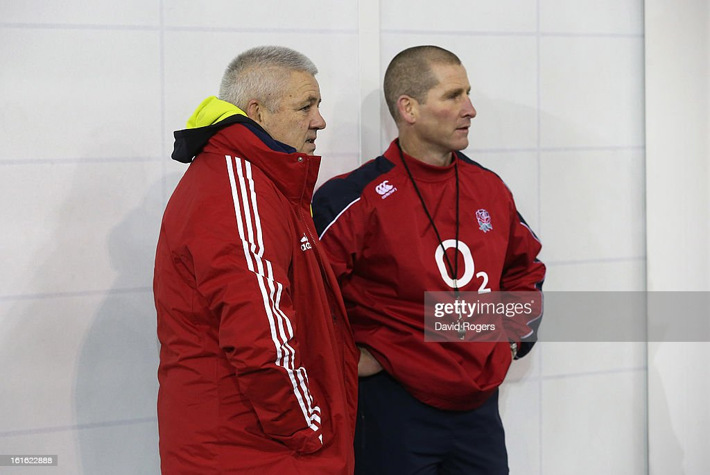 Warren Gatland (L) the British and Irish Lions head coach talks to England head coach Stuart Lancaster during the England training session held at St Georges Park on February 13, 2013 in Burton-upon-Trent, England.