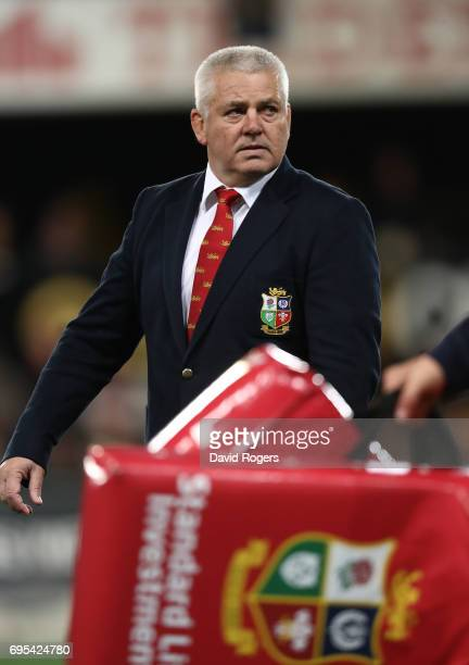 Warren Gatland the head coach of the Lions watches over his team's warm up during the 2017 British Irish Lions tour match between the Highlanders and...