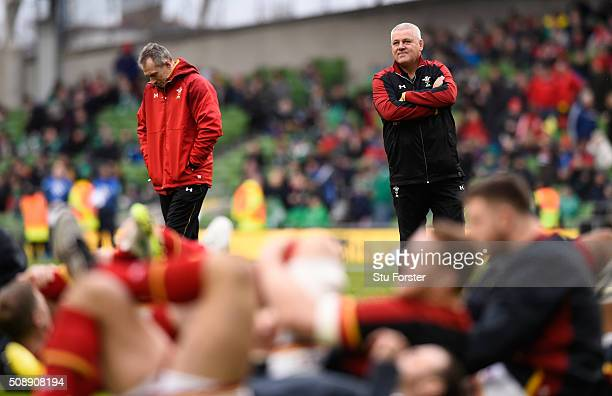 Warren Gatland the head coach of Wales and Rob Howley the Wales attack coach watch over their team's pre match warm upduring the RBS Six Nations...