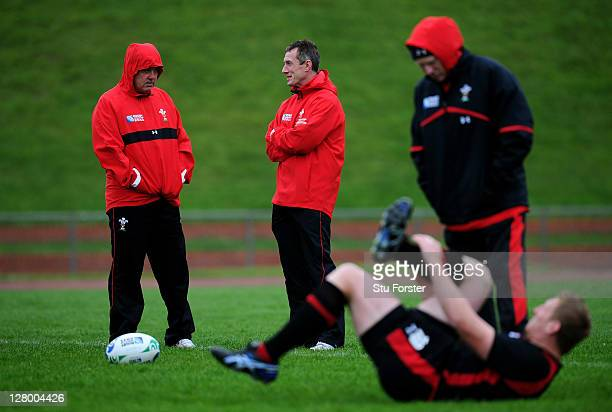 Warren Gatland the head coach of Wales speaks with assistant coach Rob Howley during a Wales IRB Rugby World Cup 2011 media session at Newtown Park...