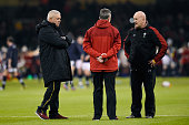 Warren Gatland the head coach of Wales speaks with his assistants Rob Howley and Shaun Edwards prior to kickoff during the RBS Six Nations match...