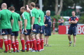 Warren Gatland the Lions head coach looks on with assistant coach Rob Howley during the British and Irish Lions training session held at the Aberdeen...