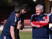 Warren Gatland the Lions head coach shares a joke with Andy Farrell the defence coach and Rob Howley the backs coach during the British and Irish...