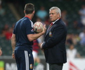 Warren Gatland the Lions head coach talks to Rob Howley the backs coach during the match between the British Irish Lions and the Barbarians at Hong...