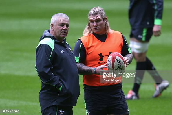 Warren Gatland the Wales head coach looks on with Wales hooker Richard Hibbard during the Wales captain's run at the Millennium Stadium on February 5...