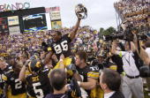 Warren Holloway of the Iowa Hawkeyes is carried on the field by teammates following the Capital One Bowl game against the LSU Tigers at the Florida...