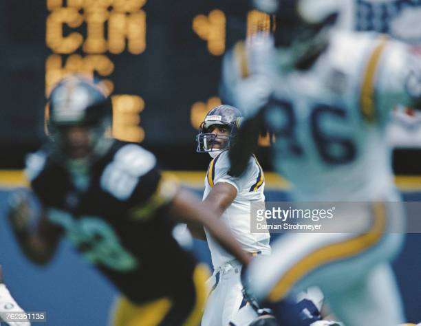 Warren Moon Quarterback for the Minnesota Vikings prepares to pass to wide receiver Jake Reed during the National Football Conference Central game...