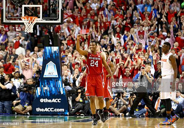 J Warren of the North Carolina State Wolfpack celebrates after defeating the Syracuse Orange 6663 during the quarterfinals of the 2014 Men's ACC...