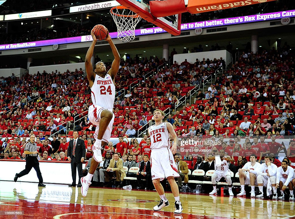 T.J. Warren #24 of the North Carolina State Wolfpack drives for an uncontested dunk against the North Carolina-Asheville Bulldogs during play at PNC Arena on November 23, 2012 in Raleigh, North Carolina. North Carolina State won 82-80.