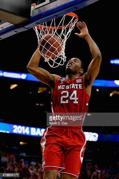 J Warren of the North Carolina State Wolfpack dunks the ball on a breakaway in the first half against the Saint Louis Billikens during the second...