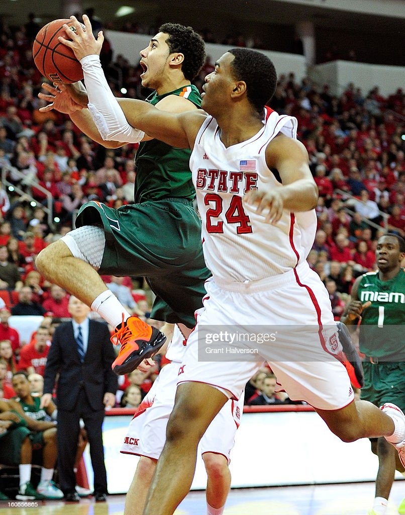T.J. Warren #24 of the North Carolina State Wolfpack fouls Shane Larkin #0 of the Miami Hurricanes on a drive to the basket during play at PNC Arena on February 2, 2013 in Raleigh, North Carolina. Miami won 79-78.