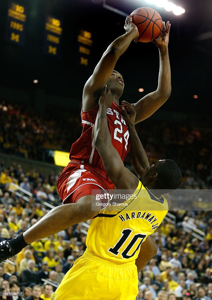 T.J. Warren #24 of the North Carolina State Wolfpack gets a second half shot over Tim Hardaway Jr. #10 of the Michigan Wolverines at Crisler Center on November 27, 2012 in Ann Arbor, Michigan. Michigan won the game 79-72.