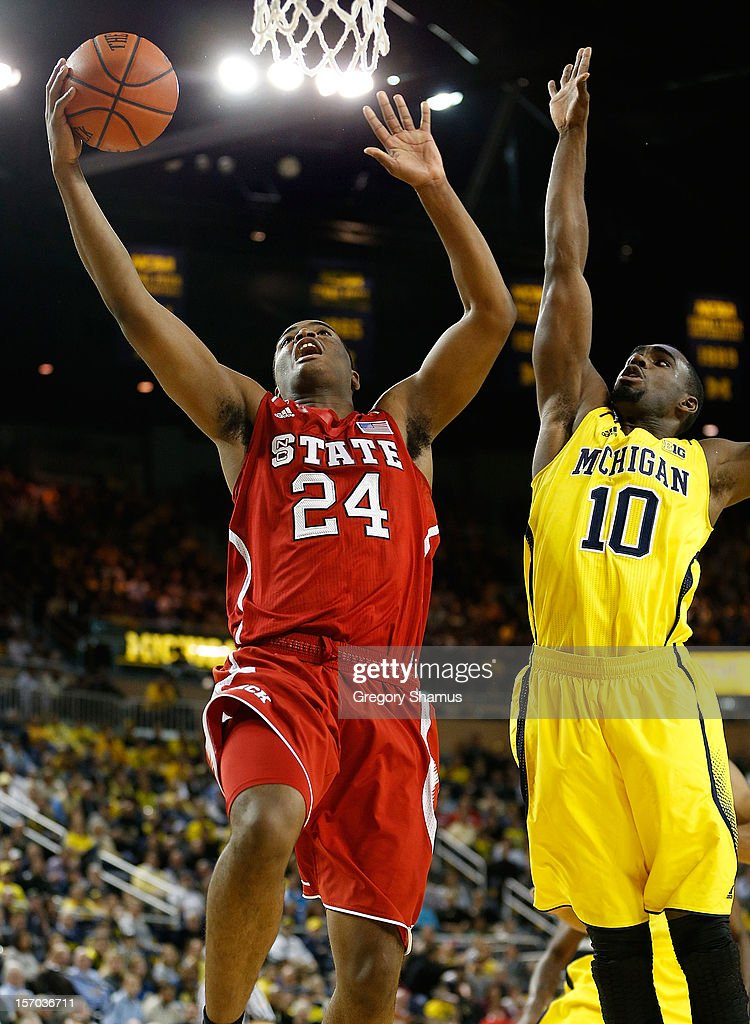 T.J. Warren #24 of the North Carolina State Wolfpack gets to the basket past Tim Hardaway Jr. #10 of the Michigan Wolverines during the second half at Crisler Center on November 27, 2012 in Ann Arbor, Michigan. Michigan won the game 79-72.