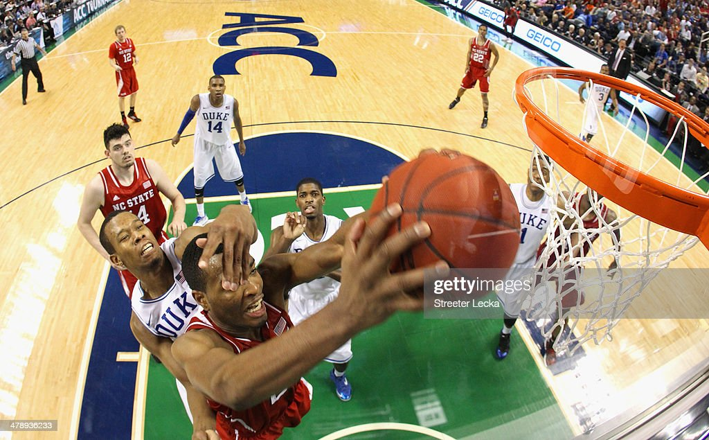 T.J. Warren #24 of the North Carolina State Wolfpack is hit in the face by Rodney Hood #5 of the Duke Blue Devils during the semifinals of the 2014 Men's ACC Basketball Tournament at Greensboro Coliseum on March 15, 2014 in Greensboro, North Carolina.