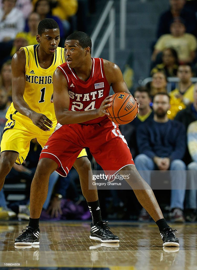 T.J. Warren #24 of the North Carolina State Wolfpack looks for a pass while playing the Michigan Wolverines at Crisler Center on November 27, 2012 in Ann Arbor, Michigan. Michigan won the game 79-72.