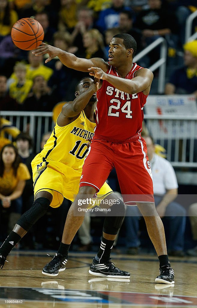 T.J. Warren #24 of the North Carolina State Wolfpack passes the ball off while playing the Michigan Wolverines at Crisler Center on November 27, 2012 in Ann Arbor, Michigan. Michigan won the game 79-72.