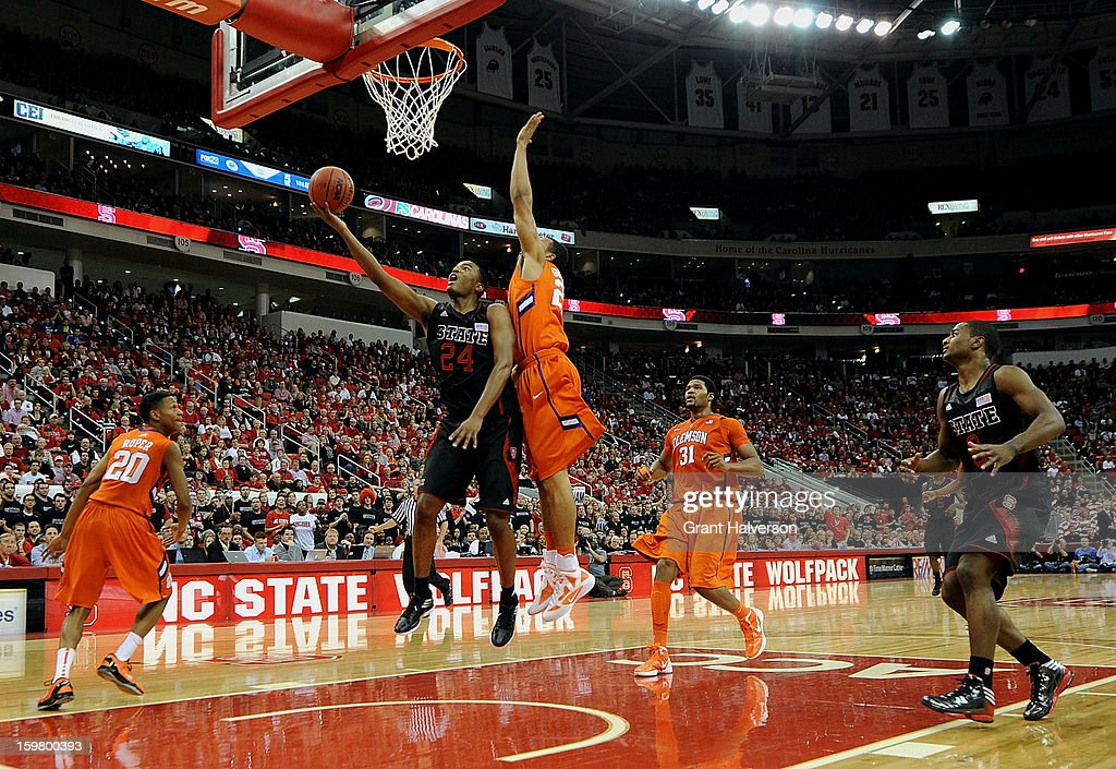 T.J. Warren #24 of the North Carolina State Wolfpack scores against defender Milton Jennings #24 of the Clemson Tigers during play at PNC Arena on January 20, 2013 in Raleigh, North Carolina. North Carolina State won 66-62.