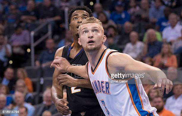 J Warren of the Phoenix Suns and Domantas Sabonis of the Oklahoma City Thunder watch a free throw during the first half of a NBA game at the...