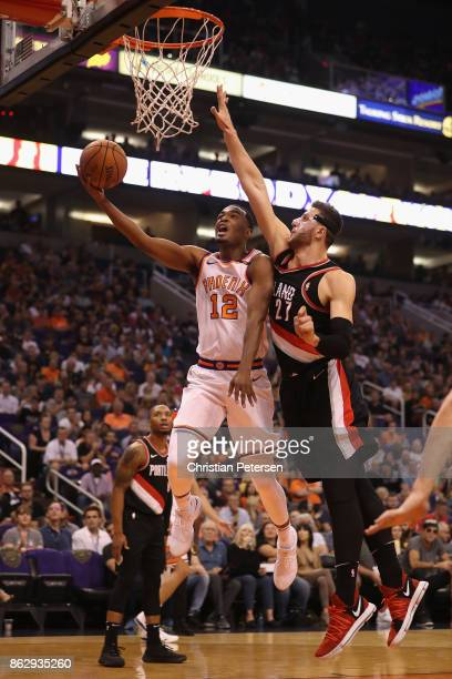 Warren of the Phoenix Suns attempts a lay up past Jusuf Nurkic of the Portland Trail Blazers during the first half of the NBA game at Talking Stick...