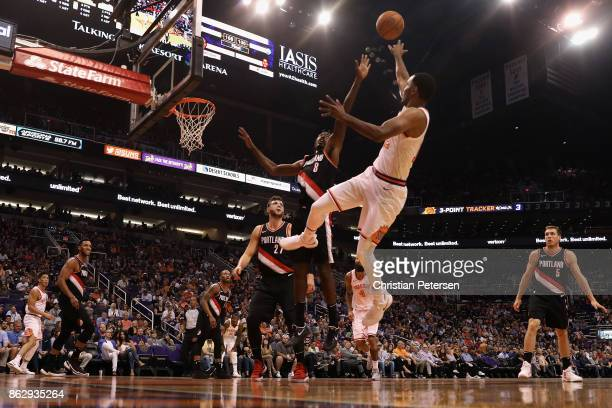 Warren of the Phoenix Suns attempts a shot over AlFarouq Aminu of the Portland Trail Blazers during the first half of the NBA game at Talking Stick...